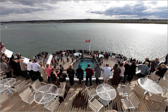 Passengers stood on the deck as the MS Balmoral Titanic memorial cruise ship departed.