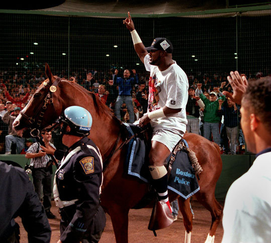 1995: Mo Vaughn gets on a horse Mo Vaughn rode on a Boston police horse after the Red Sox clinched the American League East in 1995. 'Watching Mo Vaughn trying and finally getting on a police horse to ride around Fenway after clinching the division title. I thought the poor horse would break in two!' Joy in Boston said. 'Also, Cal Ripkin's last game at Fenway -- we were all in tears for such a class act to be actually retiring.'