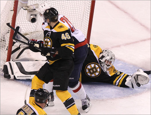 Bruins goalie Tim Thomas dove across the crease to make a glove save during the third period. Thomas had 17 saves.