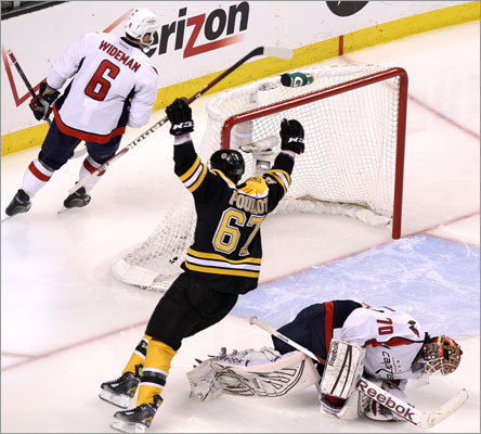 Bruins wing Benoit Pouliot celebrated after Chris Kelly (not pictured) scored the only goal of the game in overtime to lift the Bruins to a 1-0 victory over the Capitals in the first game of their playoff series. Game 2 is Saturday at TD Garden.