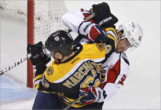 Capitals defenseman Mike Green and Bruins left wing Brad Marchand mixed it up during the first period.