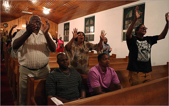 People rejoiced during a special service for Trayvon Martin held at the Allen Chapel in Sanford, Fla.