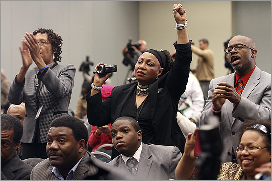 People in the crowd cheered during a news conference at the Washington Convention Center in Washington, D.C., about the arrest of George Zimmerman.