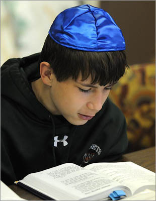 "At Congregation Ahavath Torah in Stoughton, Jewish children will perform good deeds as part of a South Area Community Mitzvah Day. ""We want to show the younger generation the importance of offering help to others without being asked,"" said Sue Rosman, director of the event. ""We're building the memories that children will have to go back to. It's the foundation of their Jewish identity."" At Temple Beth Emunah in Brockton, special needs student Michael Jacobson, 12, of Mansfield studies ."