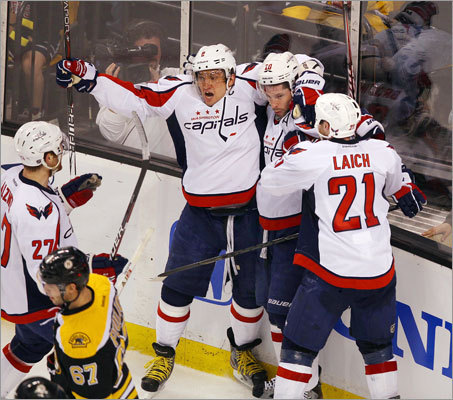 The Capitals celebrated Troy Brouwer's second period goal against the Bruins to put them up 1-0. From left to right: Alex Ovechkin, Brouwer and Brooks Laich.