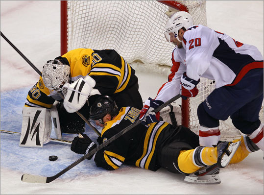 Tim Thomas couldn't stop this goal in the second period by the Capitals' Troy Brouwer at close range as Greg Zanon was sprawled in front.