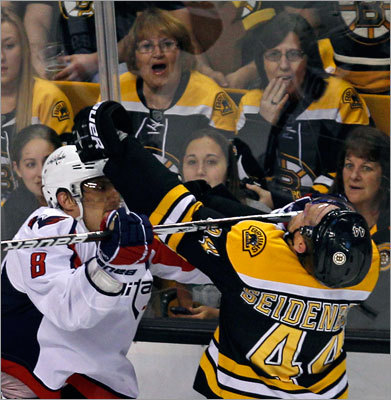 Boston Bruins defenseman Dennis Seidenberg (44) got a stick to the face from Washington Capitals left wing Alex Ovechkin (8) in the second period.