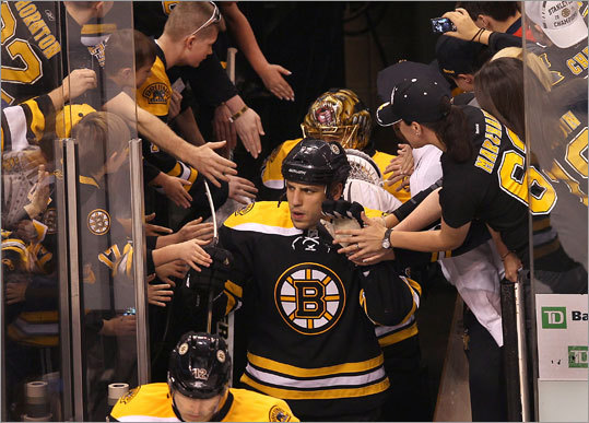 As the Bruins entered the ice at TD Garden for Game 2 of their playoff series with the Washington Capitals, Milan Lucic had his game face on while fans beckoned for recognition.