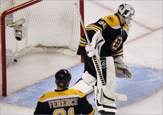 Bruins goalie Tim Thomas watched as the Capitals' Nicklas Backstrom scored the game-winning goal in the second overtime period of Game 2 in the Easter Conference quarterfinals. The Capitals tied the series 1-1.