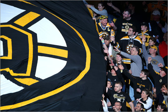 Bruins fans pulled a large banner through the stands to open up Game 2 against the Washington Capitals. It's become a tradition to pull a large banner through the stands to open playoff games.