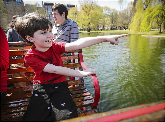 Another happy customer: Alex Surette, 8, took a ride on a Swan Boat on a beautiful spring day in Boston. Skies were clear and temperatures were in the low 70s in the Common on opening day in April.