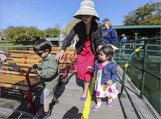 Reiko Feinberg, center, helped her two children board one of the boats.