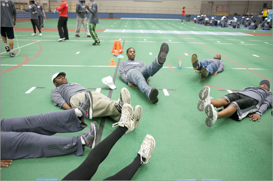 Students of Boston Public High School track teams trained with defending men's marathon champion Geoffrey Mutai, defending women's winner Caroline Kilel, and Desiree Davila, Bill Rodgers and Greg Meyer at the Reggie Lewis Track and Athletic Center in Roxbury on Wednesday, April 11.