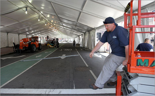Workers spent Friday preparing the medical tent, a place that figured to be busy after the marathon because of the high temperatures forecast.