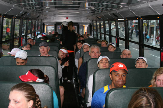 Runners take their seats on the bus prior to the ride out to Hopkinton.