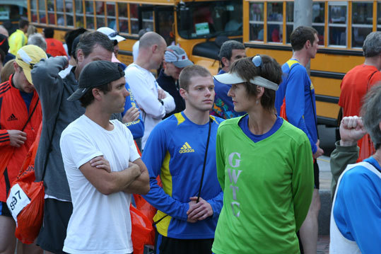 Mary Vancore (right, green shirt), from Tallahassee, Fla., is representing her running club in her second marathon. 'I'll be OK because I train in Florida,' she said. Dan Tirozzi (white t-shirt) from Los Angeles is running his 13th marathon while Kevin Abbott (center), from Boston is running his first marathon today. 'I'm 25-years-old so I should be fine,' Abbott said about any concerns with the heat.