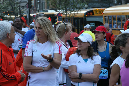 Kristen Kelly (left) and Gail Bierman arrived from Virginia Beach, Va. to run in today's race. 'I'm not lovin' it,' said Kelly, who hopes to complete her seventh Boston Marathon.