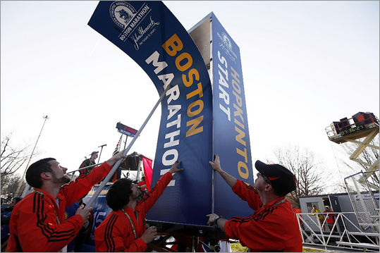 The starting-line sign for the Boston Marathon is added before the race on Monday, April 16.