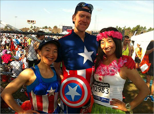 Super heroes and a hula girl prepared for the Marathon at Athlete's Village.