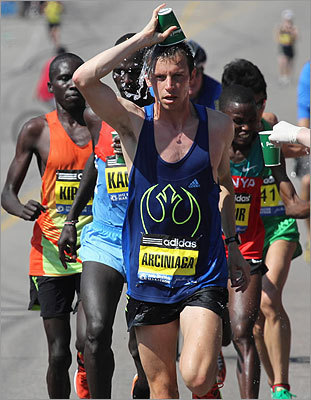 American elite runner Nicholas Arciniaga cooled off on the Boston Marathon course on April 16, 2012.