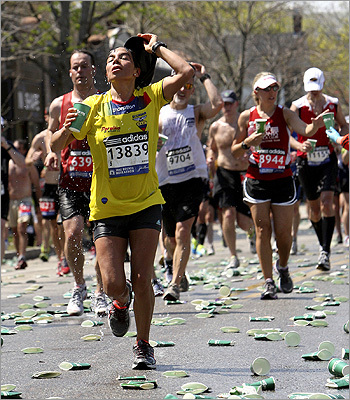 Maritza Rodriguez of Ecuador and runners cooled off at a water station on Heartbreak Hill/