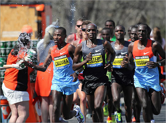 Kenyan Dickson Chumba struggled with a cup of water during the Boston Marathon on April 16, 2012.