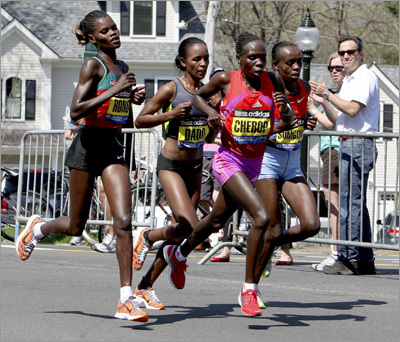 Women's leaders (from left) Georgina Rono, Firehiwot Dado, Sharon Cherop, and Jemima Jelagat Sumgong climbed Heartbreak Hill as a pack.