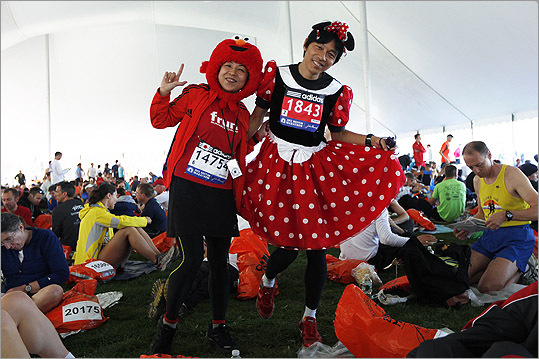 Tetsutomo Izuka (right) of Tokyo, and Maki Yamaguchi (left) of Osaka, Japan, dressed as Minnie Mouse and Elmo for the Marathon. This is Izuka's 4th and Yamaguchi's 1st.