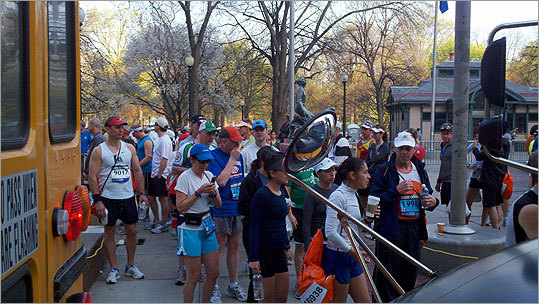 Boston Marathon runners boarded buses on April 16.