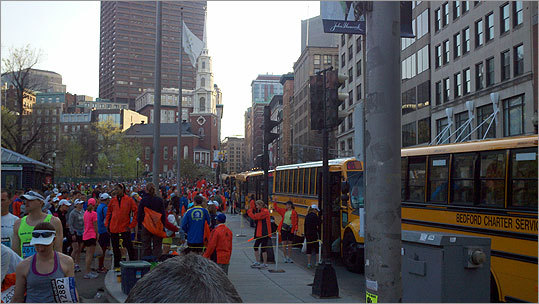 Boston Marathon runners boarded buses to Hopkinton on April 16.