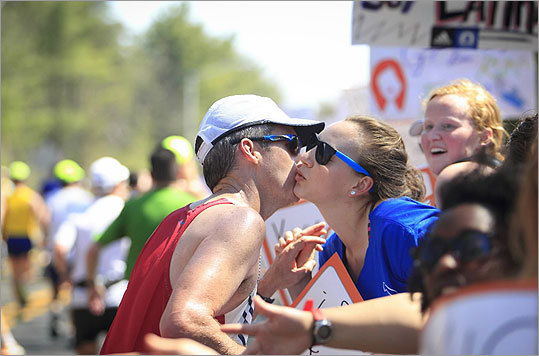 Runners stopped briefly for free kisses from Wellesley students who lined the halfway point of the Boston Marathon on April 16, 2012.