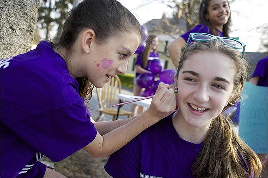 Lexie Phipps and Nicole Hudson waited along the Boston Marathon route on April 16, 2012.