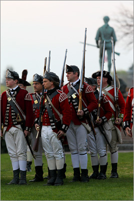In honor of the 237th anniversary of the first skirmish of the American Revolution, reenactors brought history to life on Monday as they recreated the scene at the Battle of Lexington on April 19, 1775. Read on to see scenes from the Lexington Green. In this photo the British arrive on Green with the famed Minuteman statue behind them.