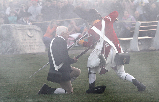 """Jim Hart, 77, is bayonetted by British soldier Mike Foley for last time after 20 years of playing the role of Jonas Parker through the smoke of gunfire, during the reenactment of the """"Battle of Lexington."""""""