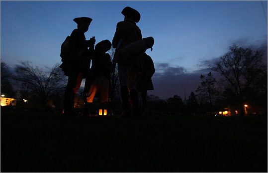 Minutemen wait on the Green during the pre-dawn hour before the re-enactment.