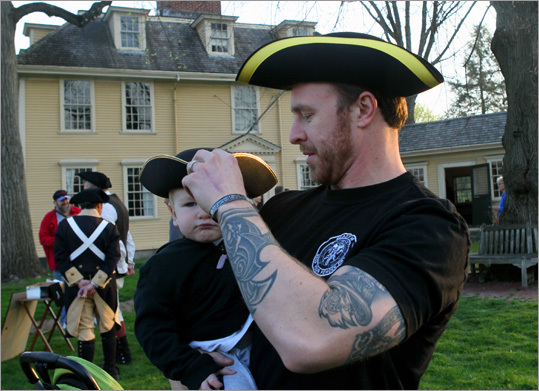 David Strysko, a real life soldier, stationed in Fort Bragg who grew up in western Ma, took his 1 1/2 year old son, Davidson to watch the early morning re-enactment on Lexington Green.