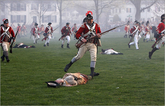 British soldier kicks injured Patriot as British run back across the Green after battle with Minutemen.