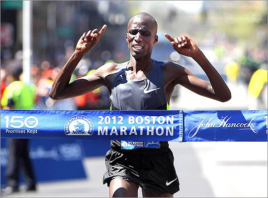 Kenya's Wesley Korir crossed the finish line to take the men's championship. His official time was 2:12:40.