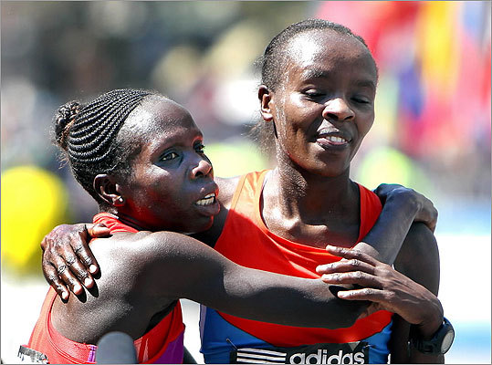 Sharon Cherop (left) hugged the second-place finisher, Jemima Jelaget Sumgong, at the finish.