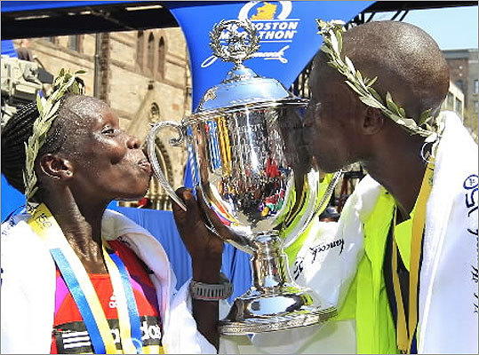 Women's winner Sharon Cherop and her fellow Kenyan, Wesley Korir, kissed the champions trophy at the finish area.