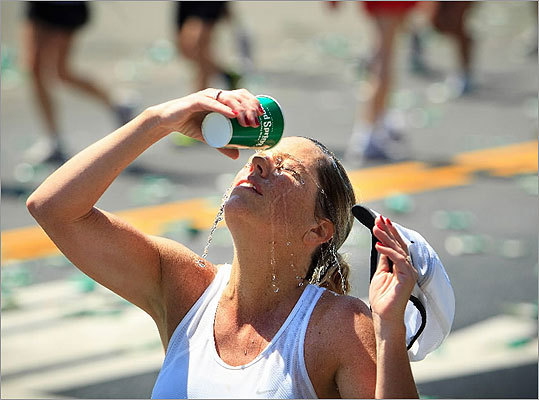 Runners doused themselves with water for some relief from the heat at the halfway point of the race.