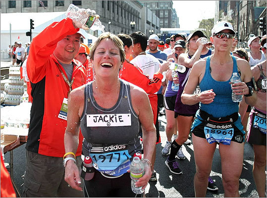 Runners had water poured over them as they crossed the finish.