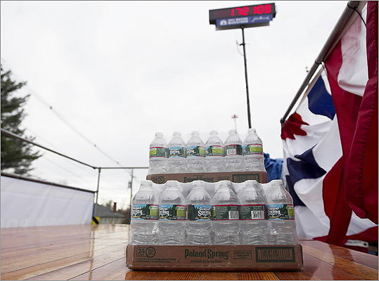 Cases of water sat on the platform at the starting line in Hopkinton. Due to the warm weather, the Boston Athletic Association announced it would allow runners who qualified for this year's race to defer running until the 2013 marathon.