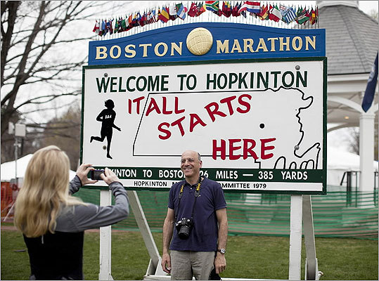 Thousands of fans were also arriving along the marathon course to cheer on runners. Katha Diddel of Greenwich, Conn., left, took a photo of David Sussman of New York City near the starting line.