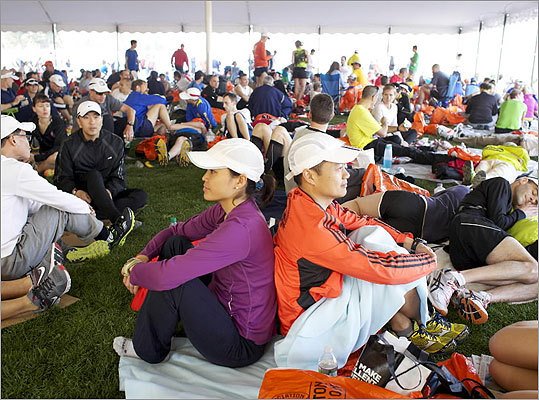 Sue Kwan (left) and Tony Jang waited in the Athletes' Village before the start of the marathon.