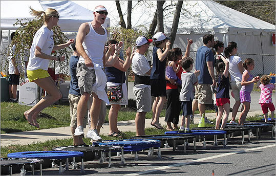 Onlookers jumped on trampolines as they waited for runners to approach.