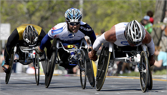 Wheelchair racers (left to right) Masazumi Soejima, Kota Hokinoue, draft Krige Schabort as they climbed Heartbreak Hill.