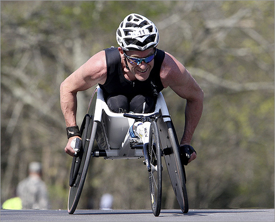 Wheelchair racer Brett McArthur smiled as he conquered Heartbreak Hill.