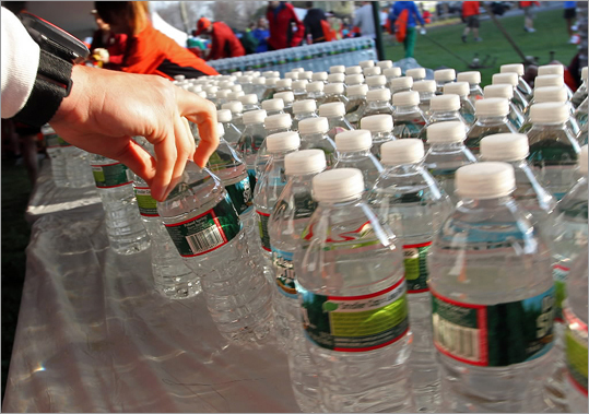 A runner grabbed water at the Athlete's Village prior to the start of the race. High temperatures are expected for the 116th running of the Boston Marathon.