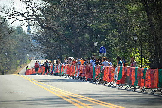 Supporters lined the streets at Wellesley College for the Boston Marathon on April 16, 2012.